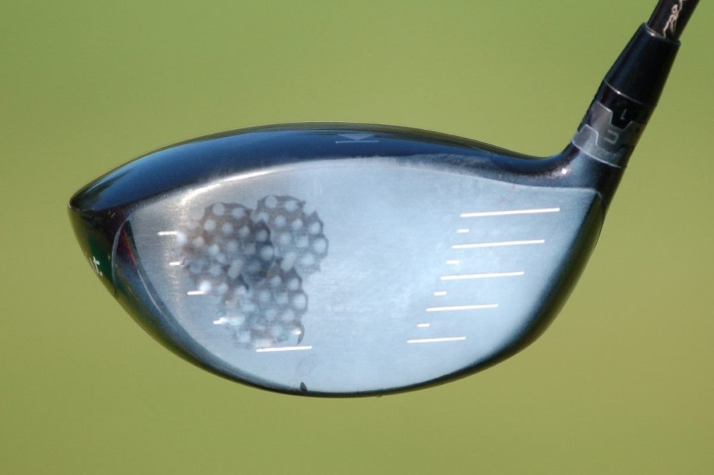 A picture containing golf, athletic game, sport, indoor  Description automatically generated